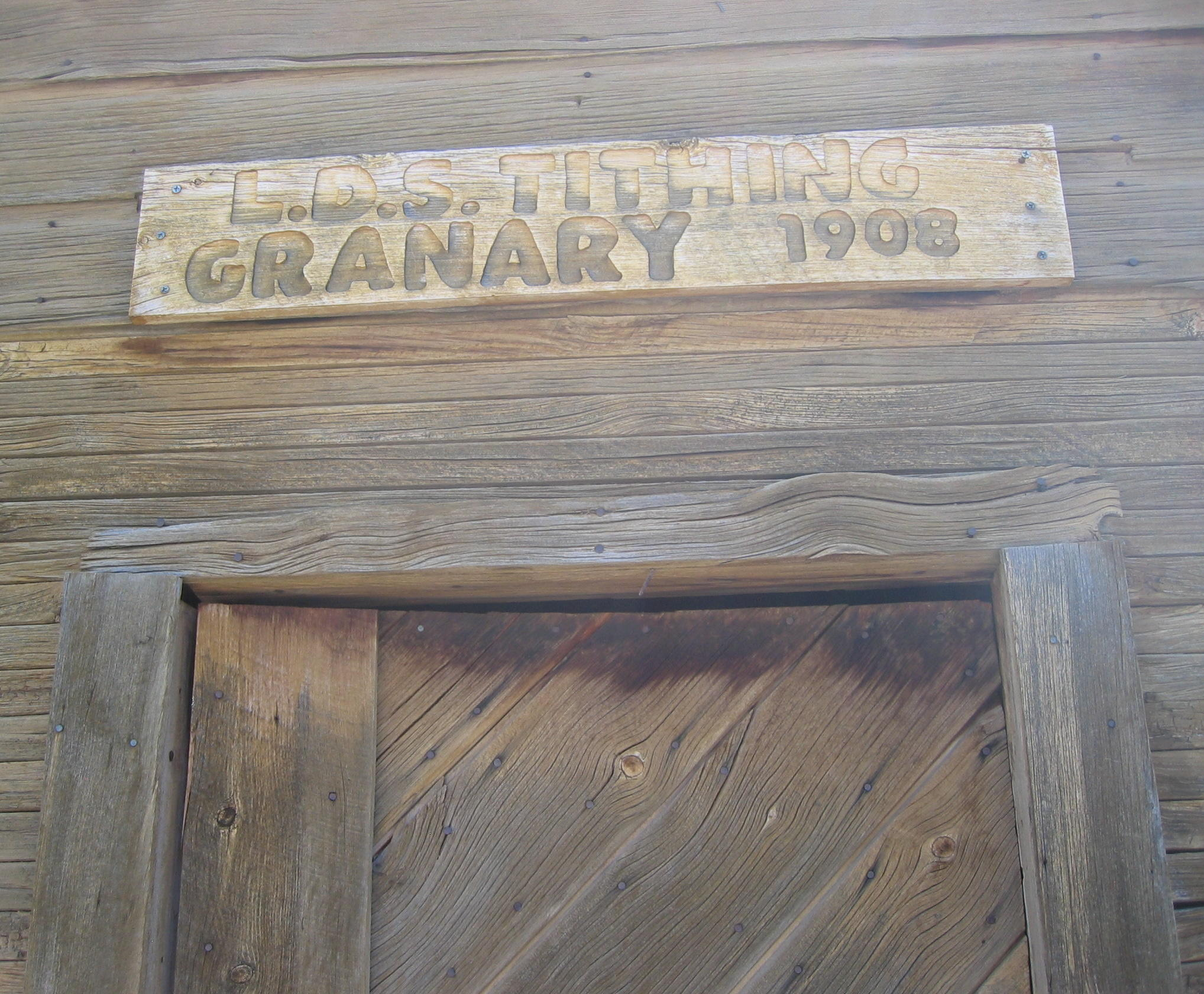 Sign above the door of the Enterprise Ward Tithing Granary