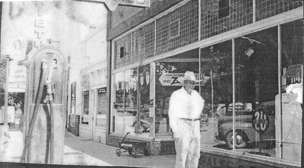 Melvin Cox and a gas pump in front of the Arrowhead store