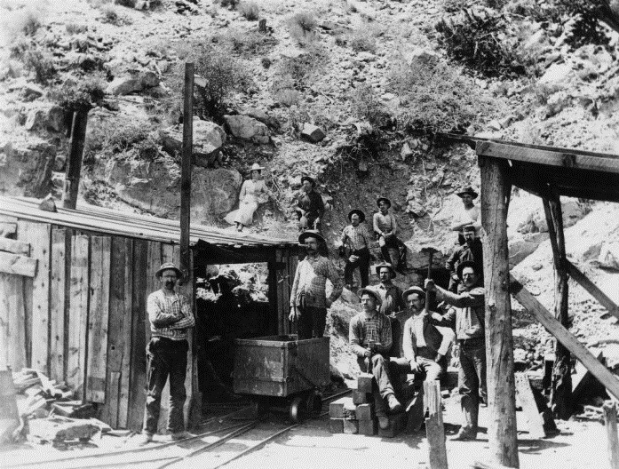 Miners at the entrance of the Apex Mine